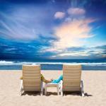 Honeymoon couple enjoy ocean sunset